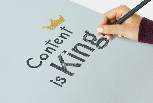 Hand writing Content is king on a paper