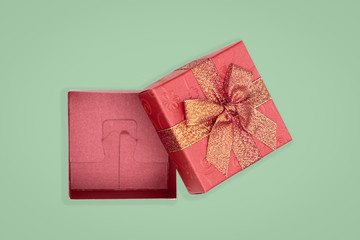 Top view of opened red gift box on green background. with copy space for text