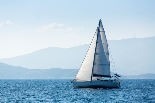 Greece sailing yacht boat at the Sea. Luxury cruise yachting.