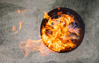 Close up paper burning in flame. Burning paper in the bin.