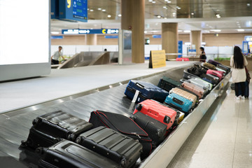 Suitcase or luggage with conveyor belt in the airport..