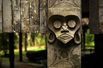 Tribal wood carved in decoration of traditional longhouse in Malaysia Fototapete