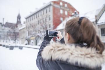 Beautiful woman in urban area during winter