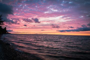 Beautiful Michigan Beach Sunset Background. Sunset along the shore of a Lake Huron beach in Cheboygan, Michigan.