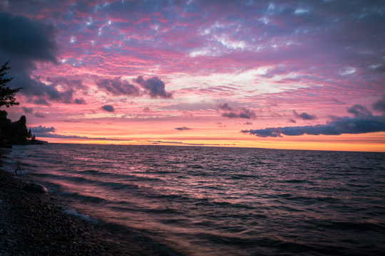 Beautiful Michigan Beach Sunset Background. Sunset along the shore of a Lake Huron beach in Cheboygan, Michigan.