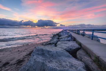 Sunrise Beach Scenic Seascape. Coastal scenic sunrise beach on the rocky shore of Lake Huron in Lexington, Michigan.