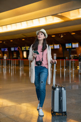 woman walking in the airport.