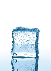 Ice cube with water drops on white background