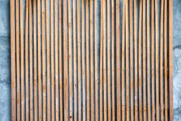 Modern wooden brown lath decoration on facade