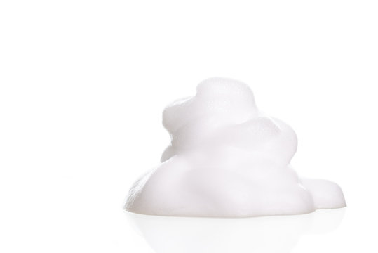 White foam bubbles texture isolated on white