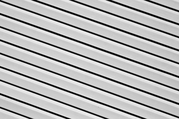 Plastic siding surface in black and white.