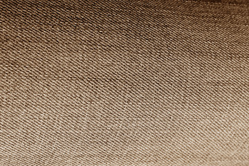 Jeans cloth pattern in brown color.