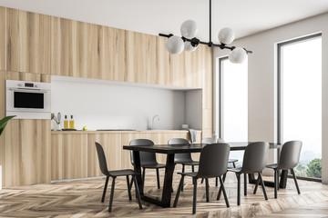 Wooden kitchen corner, black table