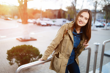 Young woman with beautiful smile posing at the sunset.