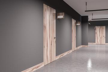 Gray hotel corridor closed wooden doors side view