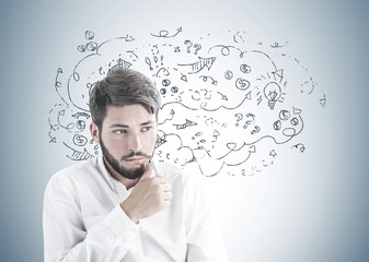 Thinking bearded young businessman make decision