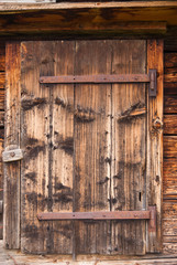 Wooden doors of the old Chalet. Lauterbrunnen, Switzerland.