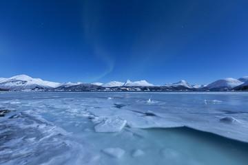 Northern Lights (Aurora borealis) on Lyngen Alps and frozen sea, Storsteinnes, municipality of Balsfjord, Troms county, Norway, Scandinavia, Europe