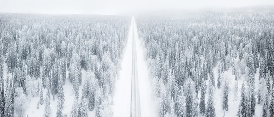 Elevated panoramic view of road along the snow covered forest, Pallas-Yllastunturi National Park, Muonio, Lapland, Finland, Europe