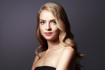 Woman with beautiful hairstyle curly blonde hair
