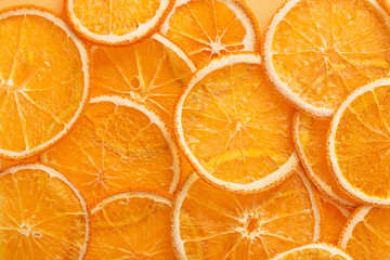 dried oranges on color paper background