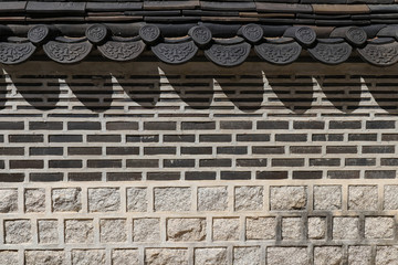 Fragment of a stone fence in Korean style