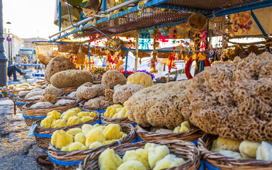 Souvenirs and sea sponges for sale on a boat in Chania, Crete, Greek Islands, Greece, Europe