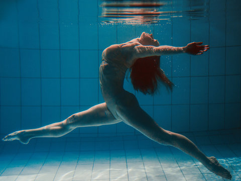 athletic sport woman underwater in the swimming pool