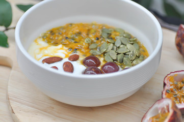 yogurt with passion fruit, almond ,sunflower seed and grape