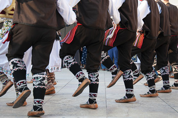Men and women dancing and wearing one of the traditional folk costume from the Republic of Serbia