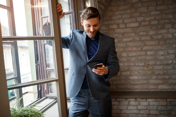 Businessperson with cell phone calling his fellow