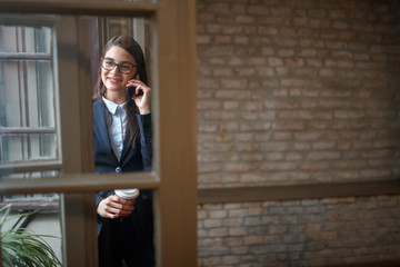 Female in pleasant conversation by phone