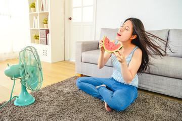 pretty woman fully enjoying her watermelon.