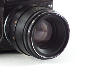 dark camera lens with diaphragm blades on white background