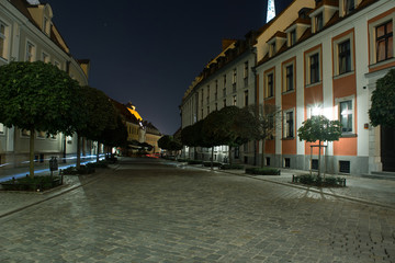 long exposure concept of old city empty street at night time with light and illuminated from lanterns