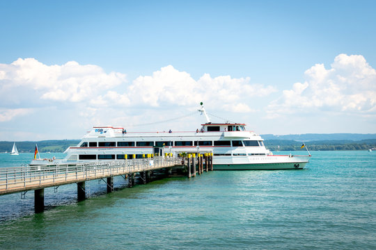 A boat with passengers at the harbor of Island Mainau, Lake Constance