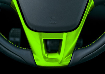 Close up view of steering wheel with green stitching, Black leather car interior design. Car interior details. Car detailing