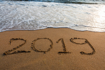 2019  on a beach sand  background