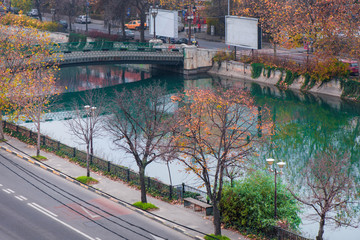 Bridge over the river in Bucharest in late autumn. Busy traffic in capital of Romania in early morning. Beautiful autumn colors