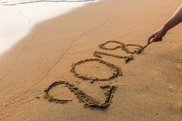 Write 2018  on a beach sand