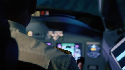 Captain is controls the airplane, rear view.