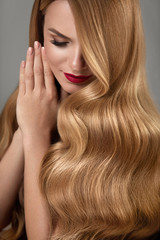 Hair Beauty. Beautiful Woman With Makeup And Long Blonde Hair