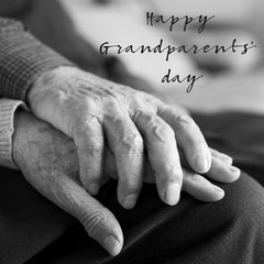 old man and woman and text happy grandparents day