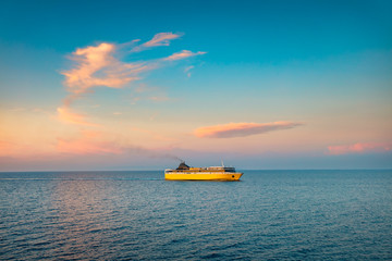 Colorful summer seascape of the Ionian Sea with a Ferry ship. Beautiful morning view of seaside. Beauty of nature concept background.