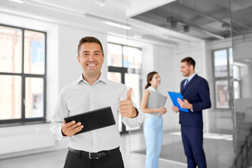 real estate business, sale and people concept - happy smiling realtor or businessman with tablet pc computer and customers at new office room