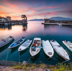 Colorful spring view of the Nafpaktos port. Fantastic sunrise in the Gulf of Corinth, Greece, Europe. Beauty of countryside concept background. Beauty of countryside concept background.