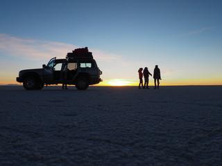 Silhouette scene during sunrise in the Salar de Uyuni, Bolivia