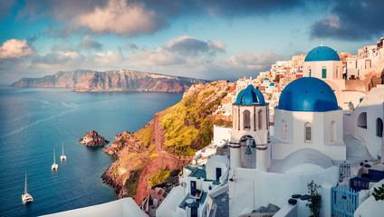 Self adhesive Wall Murals Santorini Sunny morning view of Santorini island. Picturesque spring sunrise on the famous Greek resort Oia, Greece, Europe. Traveling concept background. Artistic style post processed photo.