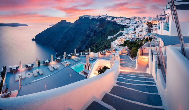 Great evening view of Santorini island. Picturesque spring sunset on the famous Greek resort Fira, Greece, Europe. Traveling concept background. Artistic style post processed photo.