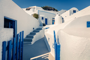 Sunny morning view of Santorini island. Picturesque spring scene of the  famous Greek resort Oia, Greece, Europe. Traveling concept background.